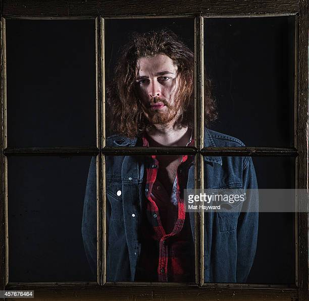 Hozier poses for a portrait behind a window before performing an EndSession hosted by 1077 The End at Fremont Abbey Arts Center on October 22 2014 in...