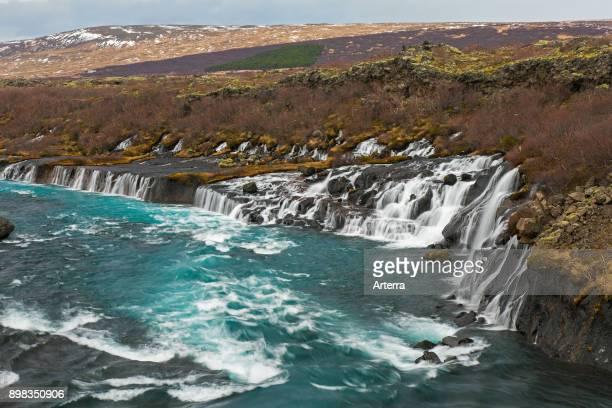 Hraunfossar series of waterfalls pouring into the Hvita river in winter Vesturland Borgarfjorour western Iceland