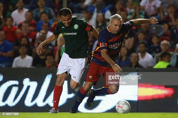 Hristo Stoichkov of Barcelona Legends struggles for the ball with Mario Mendez of Leyendas de Mexico during the match between Leyendas de Mexico and...