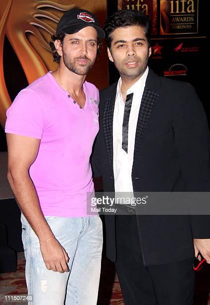 Hrithik Roshan and Karan Johar at IIFA awards press meet at JW Marriott, Mumbai on April 1, 2011.