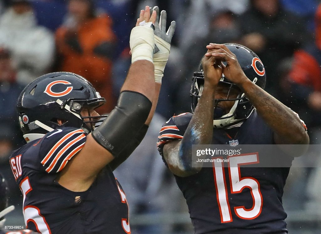 Hroniss Grasu #55 and Josh Bellamy #15 of the Chicago Bears celebrate Bellamy's touchdown catch against the Green Bay Packers at Soldier Field on November 12, 2017 in Chicago, Illinois. The Packers defeated the Bears 23-16.