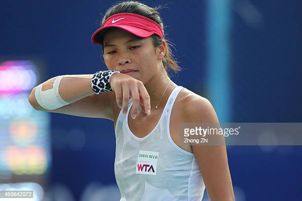 Hsieh Suwei of Chinese Taipei reacts during her match against Alize Cornet of France during day four of the 2014 WTA Guangzhou Open at Tianhe Sports...