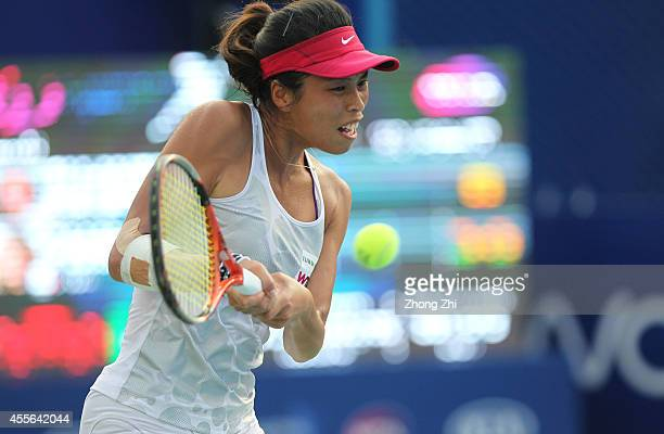 Hsieh Suwei of Chinese Taipei returns a shot during her match against Alize Cornet of France during day four of the 2014 WTA Guangzhou Open at Tianhe...