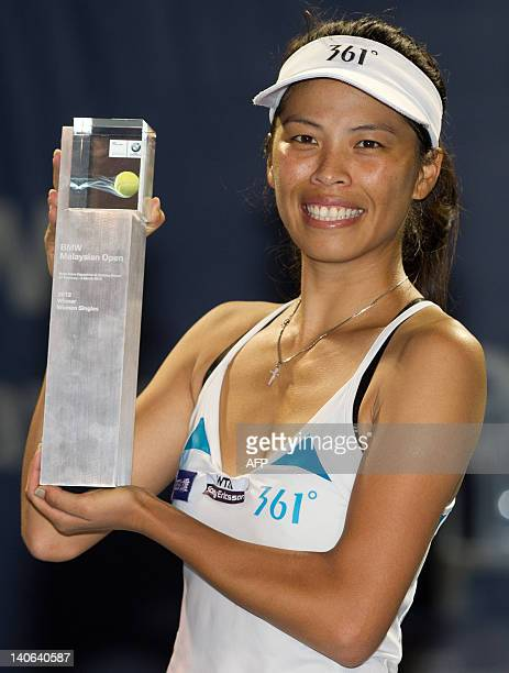 Hsieh Su-Wei of Taiwan pose with her trophy after defeating Petra Martic of Croatia during their final singles match at the BMW Malaysian Open...