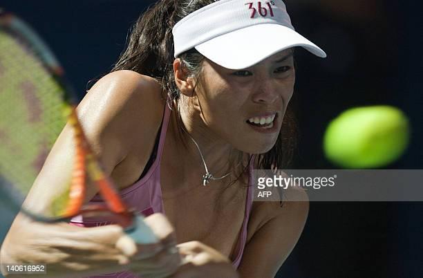 Hsieh Su-Wei of Taiwan returns a shot against Eleni Daniilidou of Greece during their semi-final singles match at the BMW Malaysian Open women's...