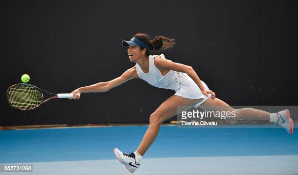 Hsieh Suwei of Taiwan returns a shot against Madison Brengle of the United States during the Women's singles qualifier second round of the 2017 China...