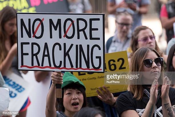 Hsingii Bird holds a sign during Enough is Enough protest in Los Angeles California August 27 2016 People gathered to protest a variety of issues...