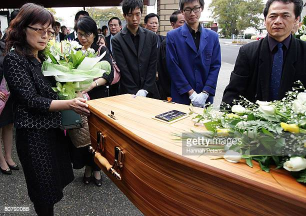 Hsiu Chuan Chen the mother of Tom Hsu looks on as her son's coffin is taken away after his funeral at Elim Christian College on April 21 2008 in...