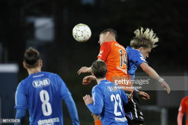 Höskuldur Gunnlaugsson of Halmstad BK and Mauricio Albornoz of Athletic FC Eskilstuna compete for the ball during the Allsvenskan match between...