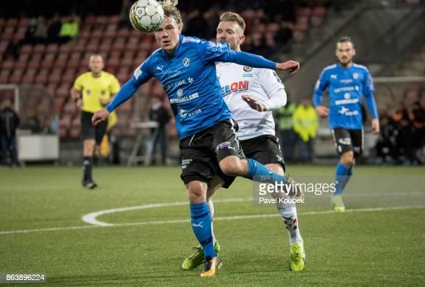 Höskuldur Gunnlaugsson of Halmstad BK & Michael Almeback of Orebro SK during the Allsvenskan match between Orebro SK and Halmstad BK at Behrn Arena...