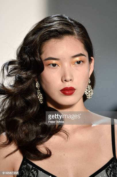 Hsu Chen walks the runway ad Tadashi Shoji Show during New York Fashion Week The Shows at Gallery I at Spring Studios on February 8 2018 in New York...