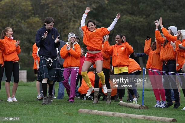 Hsu May Miss Singapore tosses the caber the Miss World Highland Games at Crieff Hotel on October 24 2011 in Crieff Scotland One hundred and twenty...