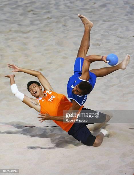 HsuHung Cheng of Taipei and Ali Hkanani of Kuwait competes in the Men's Preliminary Round Beach Handball between Taipei and Kuwait at AlMusannah...
