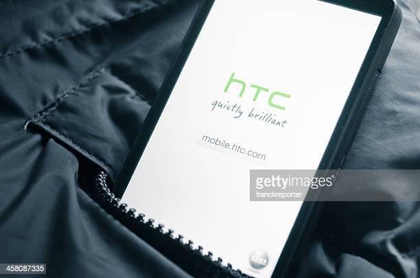 htc hd-leo smart telefon in der tasche der jacke - ganzkörper freisteller editorial stock-fotos und bilder