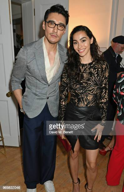 Hu Bing and Adrianne Ho attend a VIP dinner celebrating the launch of London Fashion Week Men's June 2018 hosted by David Furnish Dylan Jones and...