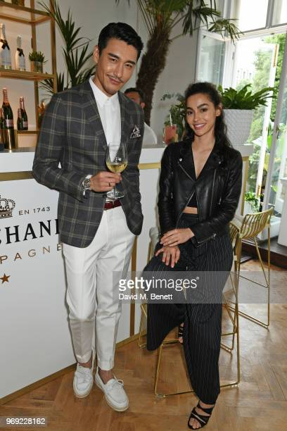 Hu Bing and Adrianne Ho attend the Moet Summer House VIP launch night on June 7 2018 in London England