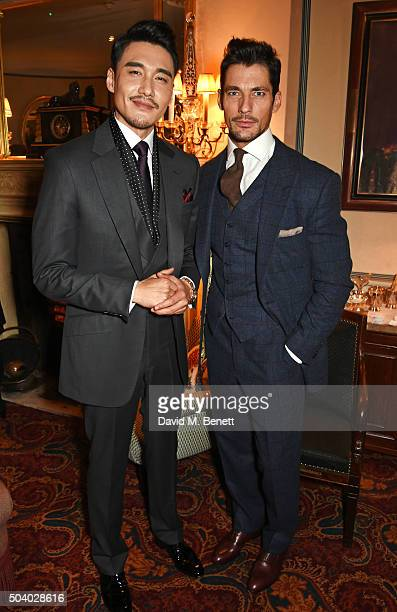 Hu Bing and David Gandy attend a cocktail reception hosted by the Woolmark Company Pierre Lagrange and the Savile Row Bespoke Association to...
