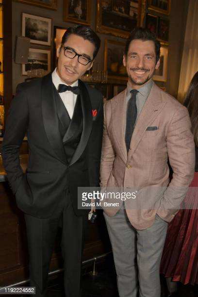 Hu Bing and David Gandy attend the British GQ dinner cohosted by Dylan Jones Jack Guinness in partnership with JPHackett No14 Savile Row during...