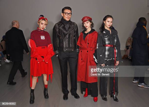 Hu Bing and members of SNH48 attend the Bobby Abley show during London Fashion Week Men's January 2018 at BFC Show Space on January 8 2018 in London...