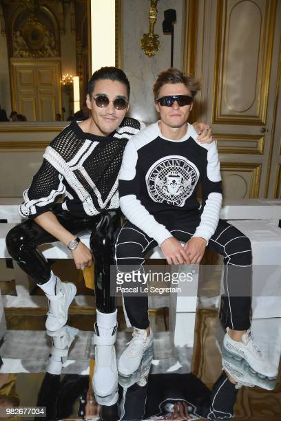 Hu Bing and Oliver Cheshire attend the Balmain Menswear Spring/Summer 2019 show as part of Paris Fashion Week on June 24 2018 in Paris France