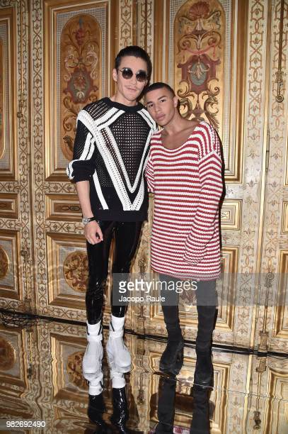 Hu Bing and Olivier Rousteing attend the Balmain Menswear Spring/Summer 2019 show as part of Paris Fashion Week on June 24 2018 in Paris France