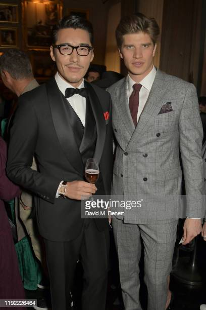 Hu Bing and Toby HuntingtonWhiteley attend the British GQ dinner cohosted by Dylan Jones Jack Guinness in partnership with JPHackett No14 Savile Row...