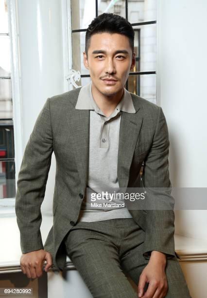 Hu Bing attends London Fashion Week Men's June 2017 collections on June 9 2017 in London England