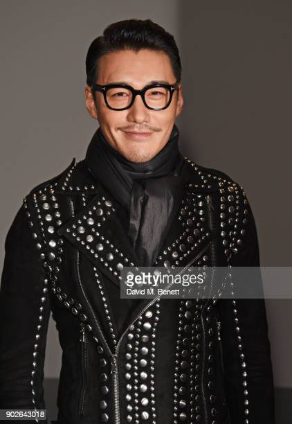 Hu Bing attends the Bobby Abley show during London Fashion Week Men's January 2018 at BFC Show Space on January 8 2018 in London England