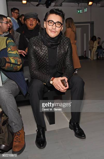 Hu Bing attends the Christopher Raeburn show during London Fashion Week Men's January 2018 at BFC Show Space on January 7 2018 in London England