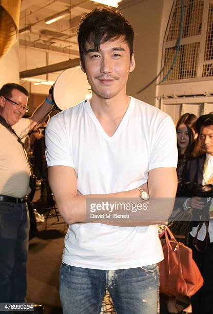 Hu Bing attends the front row at the Oliver Spencer show during London Collections Men SS16 at The Old Sorting Office on June 13 2015 in London...