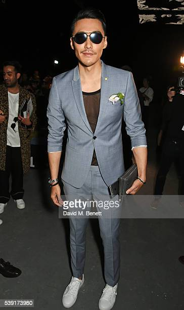 Hu Bing attends the TOPMAN Design show during The London Collections Men SS17 at the Topman Show Space on June 10 2016 in London England