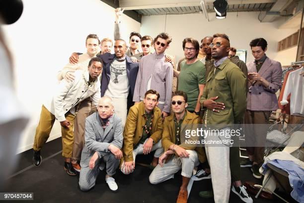 Hu Bing fashion designer Oliver Spencer Eric Underwood and models backstage ahead of Spencer's show during London Fashion Week Men's June 2018 at BFC...