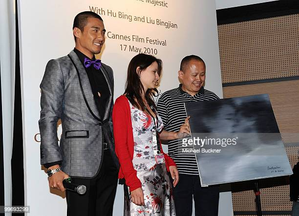 Hu Bing reporter Olga Demidova and Liu Bingjian attend the Hu Bing Cocktail Party at the Majestic Hotel during the 63rd Annual Cannes Film Festival...