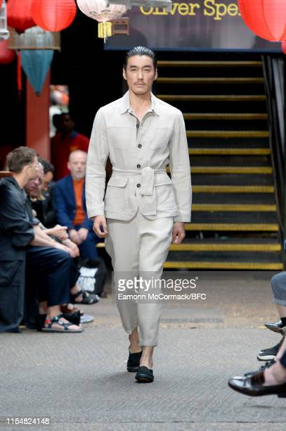 Hu Bing walks the runway at the Oliver Spencer show during London Fashion Week Men's June 2019 on June 09, 2019 in London, England.