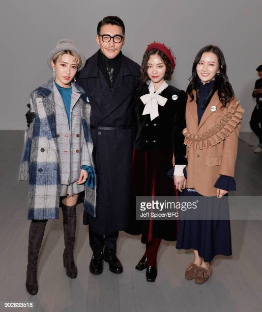 Hu Bing with members of girl group SNH48 attend the DGNAK show during London Fashion Week Men's January 2018 at BFC Show Space on January 8 2018 in...