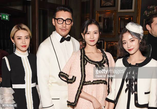 Hu Bing with members of SNH48 attend the GQ London Fashion Week Men's 2018 closing dinner hosted by Dylan Jones and Rita Ora at Berners Tavern on...