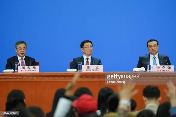 R Hu Chunhua China's vice premier Han Zheng China's executive vice premier and China's Premier Li Keqiang attends a news conference following the...