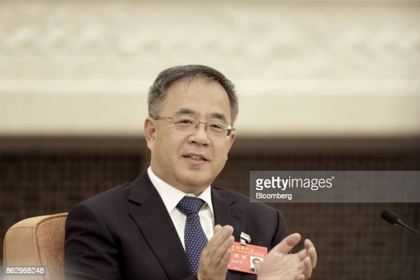 Hu Chunhua Chinese Communist Party secretary of Guangdong Province applauds during a delegation meeting at the Great Hall of the People during the...