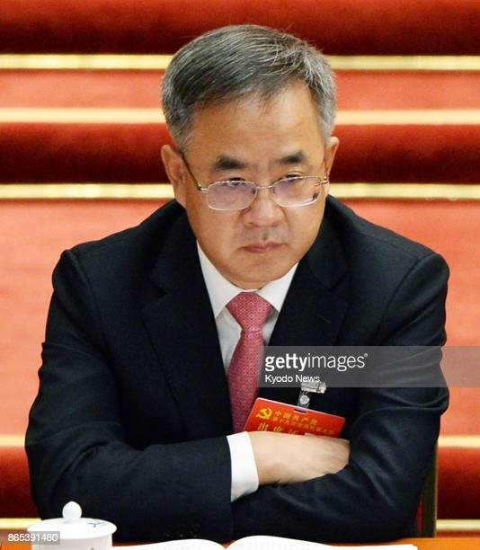 Hu Chunhua Communist Party chief of China's Guangdong Province attends the opening ceremony of the party's twiceadecade congress in Beijing on Oct 18...