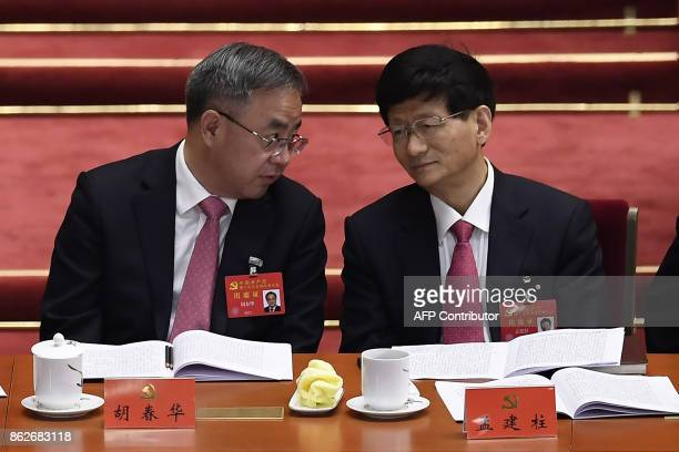 Hu Chunhua secretary of the Guangdong Provincial Party Committee and member of the Political Bureau talks with Meng Jianzhu a member of the Political...