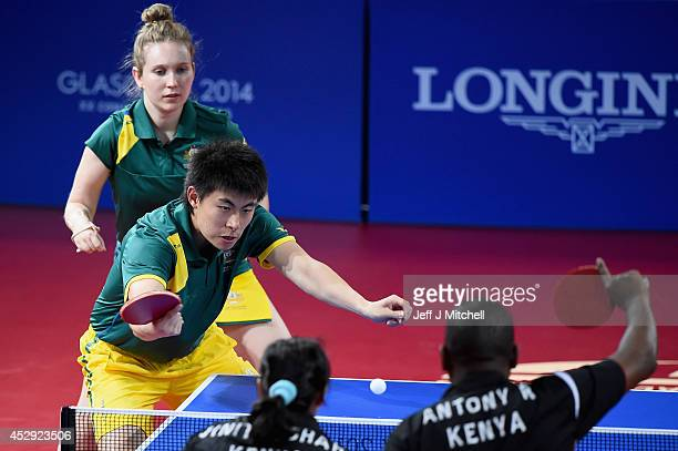 Hu Heming and Melissa Tapper of Australia compete with Anthony Ringui and Jinita Azad Kumar Shah of Kenya in the mixed doubles table tennis at...