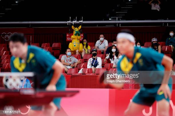 Hu Heming and Yan Xin of Team Australia in action during their Men's Team Round of 16 table tennis match on day ten of the Tokyo 2020 Olympic Games...