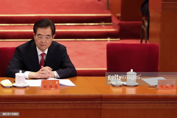 Hu Jintao China's former president attend the opening session of the Chinese Communist Party's Congress at the Great Hall of the People on October 18...
