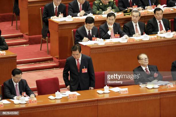 Hu Jintao, China's former president, front row center, stands as Zhang Dejiang, chairman of the Standing Committee of the National People's Congress,...