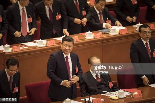 Hu Jintao China's former president front row from left Xi Jinping China's president Jiang Zemin China's former president and Li Keqiang China's...