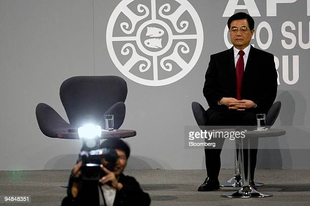 Hu Jintao Chinas president waits to speak at the AsiaPacific Economic Cooperation CEO Summit in Lima Peru on Friday Nov 21 2008 The meeting which...