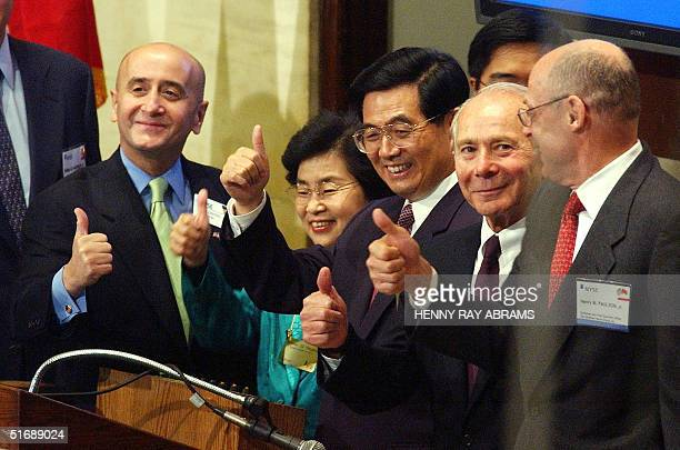 Hu Jintao VicePresident of the People's Republic of China gives a thumbsup along with his wife Liu Yongqing New York Stock Exchange Chairman Richard...