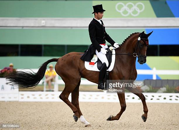 Hua Tian of China and his horse Don Geniro compete during the eventing individual dressage competition of equestrian at the 2016 Rio Olympic Games in...
