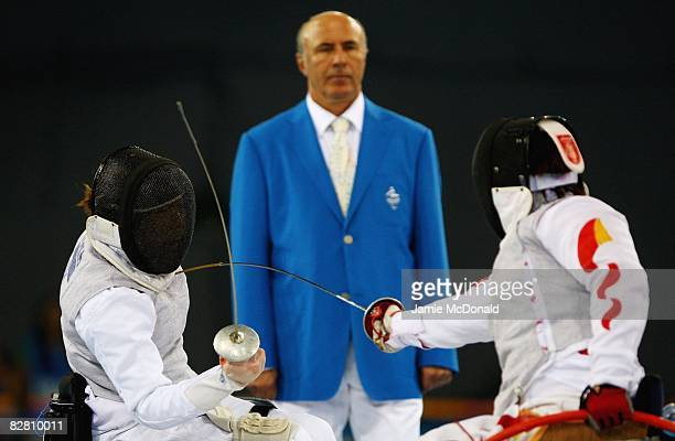 Hua Ye of China fences with Jana Saysunee of Thailand in the Individual Foil Category B Bronze Medal Match in the Wheelchair Fencing Competition at...