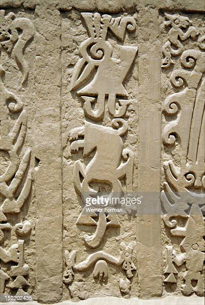 Huaca del Dragon outside Trujillo, north coast of Peru, showing detailof ceremonial platform decorated with clay frieze, Dragon headed beings in...